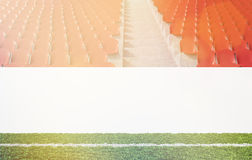 Banner at stadium. Blank banner around pitch, red seats, aisle between them. Front view. Toned, filter. Concept of sport advertising. Mock up. 3D rendering Royalty Free Stock Photos