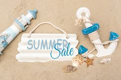 Banner summer sale. lighthouse, anchor with the inscription summer sale on a wooden background. Promotion, discount, sale