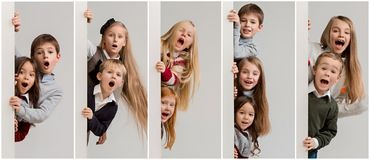 Banner with a surprised children peeking at the edge royalty free stock photo