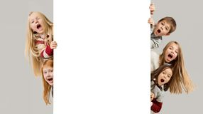 Banner with a surprised children peeking at the edge stock image