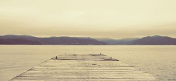 Banner Surrealism Defocus Sea landscape hills horizon sky fog nature. Natural background royalty free stock image