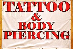 Banner with text TATTOO & BODY PIERCING Stock Photo
