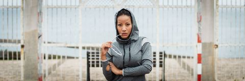 Tough looking urban fitness woman portrait royalty free stock photography