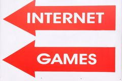 Banner with two arrow and text INTERNET GAMES Stock Image