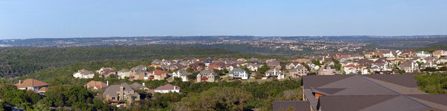 Banner view new housing. Newly build housing development in a dry, fire prone nature area.  Suburb of Austin, Texas Royalty Free Stock Images