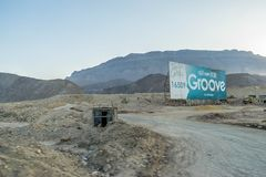 Welcome to the Groove in Egypt. Banner `Welcome to the Groove` in Egypt. Construction equipment on the background of sandy mountains royalty free stock images