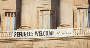 Banner wish in English welcome to the refugees Royalty Free Stock Photo