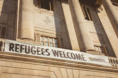 Banner wish in English welcome to the refugees. BARCELONA, SPAIN - June 20, 2017 : On the city hall of barcelona, ​​is written a banner wish in English Royalty Free Stock Photos