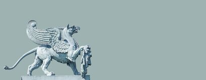 Banner With An Old Statue Of Medieval Griffin, A Hybrid Of Lion And Bird, On The Top Of The State Opera House In Downtown Of Royalty Free Stock Photo