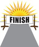 Finish Line. A banner with the word finish marks the end of a race with the sun setting in the distance Stock Image