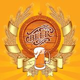 Banner with wreath of spikelets, a glass and barrel of beer Stock Images