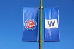 Banners Fly at Wrigley Field, Chicago after Cubs World Series Win. Blue banners show the Cubs logo and the `W` at Wrigley Field Chicago after the 2016 baseball Royalty Free Stock Images