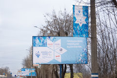 Banners hung on poles streets during the Paralympic Torch Relay. TVER, RUSSIA - MARCH 2, 2014: Banners hung on poles streets during the Paralympic Torch Relay Royalty Free Stock Photos