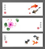 Banners with koi carps, gold fishes and lotus flowers in water. Traditional oriental ink painting sumi-e, u-sin, go-hua Stock Image