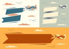 Banners met vliegtuig Stock Afbeeldingen