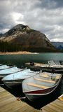 Bannf mountains view lake minniewanka fishing boats Stock Photo
