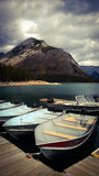 Bannf mountains view lake minniewanka fishing boats Stock Photos