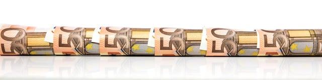 Bannière avec d'euro notes roulées Photos stock