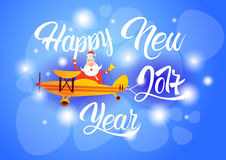 Bannière de célébration de carte de voeux de décoration de nouvelle année de Santa Clause Flying Airplane Happy Image stock