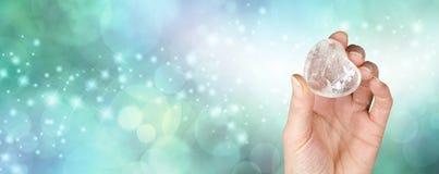 Bannière de thérapie par les cristaux avec le fond de vert de bokeh Images libres de droits