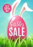 Bannière de vente de Pâques avec l'oeuf, oreilles de lapin de Pâques, autocollant de remise jusqu'à 50  Photo stock