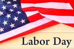 Bannière heureuse de Fête du travail, fond patriotique américain, texte sur le drapeau des Etats-Unis d'Amérique image stock