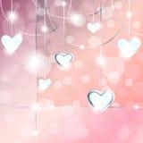 Bannière scintillante avec les pendants en forme de coeur Images stock