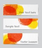 Bannières avec les cercles jaunes, rouges et oranges Photos stock