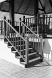 Bannister shadow on wooden stair step Royalty Free Stock Photo