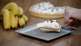 Banoffee Banana Pie in plate on wooden table background. Delicious banana cake on table. stock video