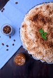 Banoffee pie topped with whipped cream and sprinkled with ground coffee. Top view stock photos