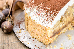 Banoffee pie on wooden table in soft light. Selective focus and close up Stock Photo