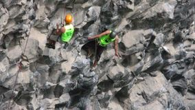 Confident Rock Climbers During Basalt Of Tungurahua Competition. Banos, Ecuador - 30 May 2015: Professional Rock Climbers At Basalt Of Tungurahua Competition In stock video