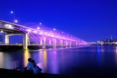 Banpo bridge rainbow fountain show at night in Seoul, Soth Korea. Stock Photo