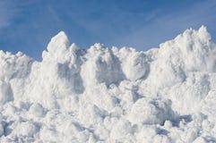 Banque empilée de neige Photos stock