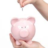 Banque rose d'argent avec l'argent entrant Photo stock