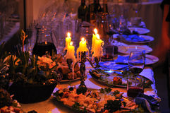 Banquet. Table with candle, flower, snack Stock Images