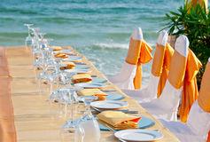 Banquet at the Beach. A table set up on the beach for a special occasion such as a wedding Royalty Free Stock Image