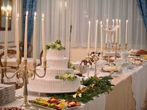 Banquet or buffet dessert table set wedding cake. Banquet or buffet dessert table set romantic wedding cake stock images