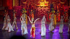 The Banquet Dance in the Song Palace. With exceptional traditional costumes of the emperor and empress, palace officials, and palace entertainers, all dancing Royalty Free Stock Image