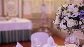 Banquet decorated table, with cutlery. Wedding decor in the banquet hall. Serving of a festive table, plate, napkin. Knife, fork. Table setting decoration stock footage