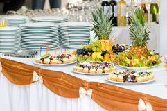 Banquet dessert table. Served banquet dessert table, sliced fruits, cakes Royalty Free Stock Images