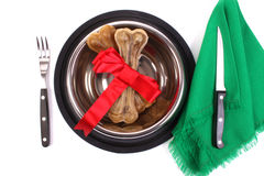 Banquet for a dog. World Animal Day is celebrated each year on 4 October. It started in Florence, Italy in 1931 at a convention of ecolog Stock Images
