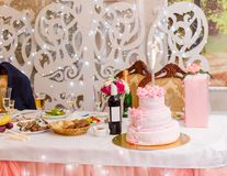 Banquet feast. And pink cake Stock Image