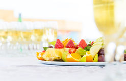 Banquet fruit plate and champagne glasses Stock Photos