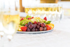 Banquet fruit plate with champagne glasses Royalty Free Stock Images