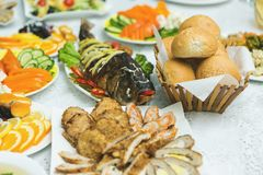 Banquet hall of the restaurant, beautifully decorated tables with food Stock Photos