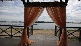 Banquet hall on the shores. Wedding ceremony on the shore. Banquet hall on the shores. Wedding ceremony on the nature and dicoated table, soft evening light Stock Image