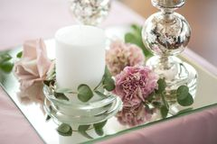 Banquet pink table decorated with fresh flowers and candles. Wedding decoration concept.  stock photo
