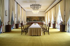 Banquet Room in Reunification Palace Vietnam. Large banquet room in the Independence or Reunification Palace, a landmark in Ho Chi Minh City, Vietnam Royalty Free Stock Images